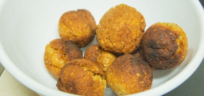 A few falafels in a bowl.