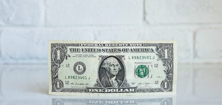Photo of a one dollar bill.