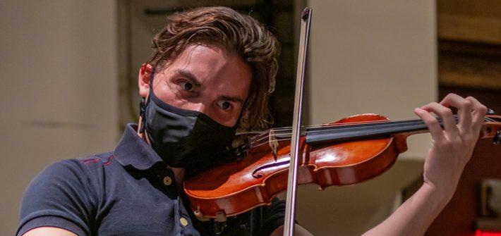 Juan plays the violin at Wilson Hall.