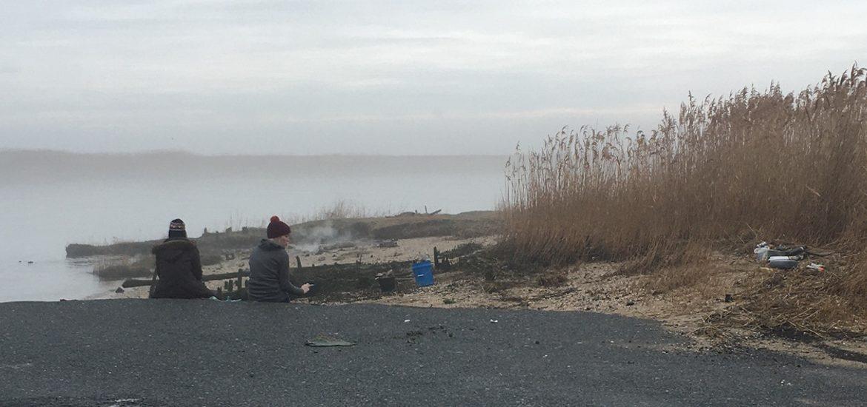 Madison sitting near a lake.