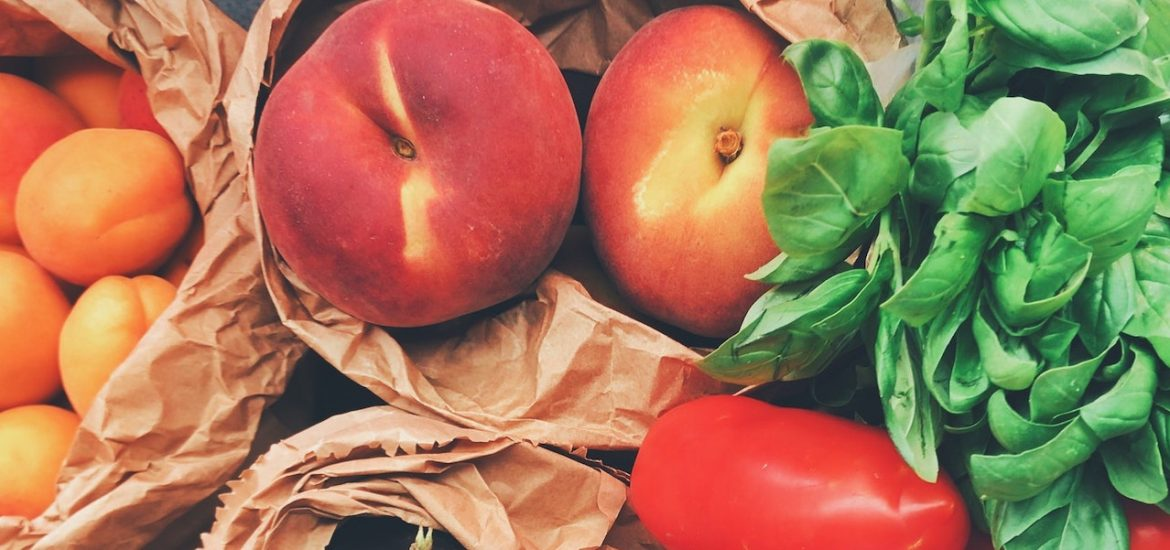 A stock image of peaches, basil and tomatoes.
