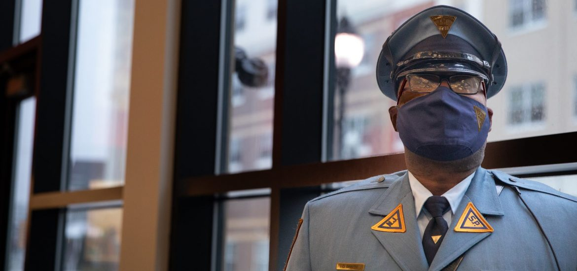 Sgt. Barnes stands in front of a bank of windows.