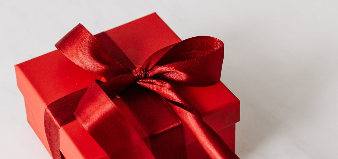 Red gift box with bow.