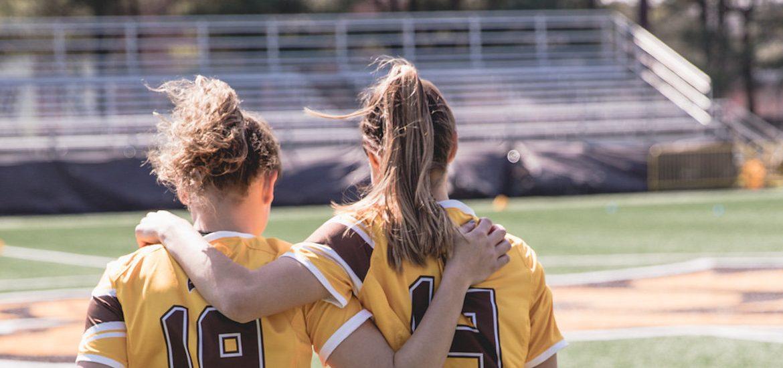 Rowan women athletes on the field.