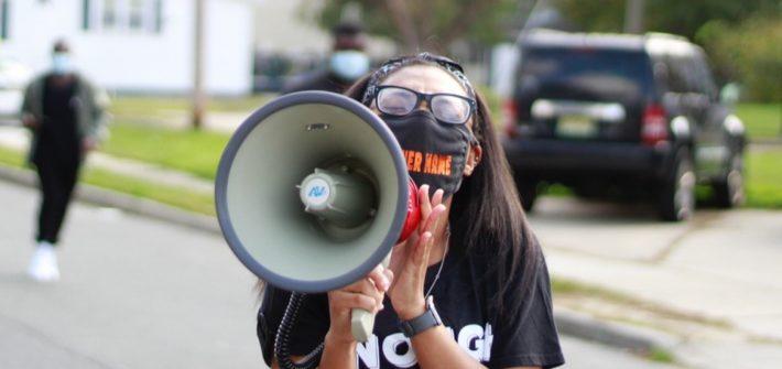 Alayna holding a megaphone.