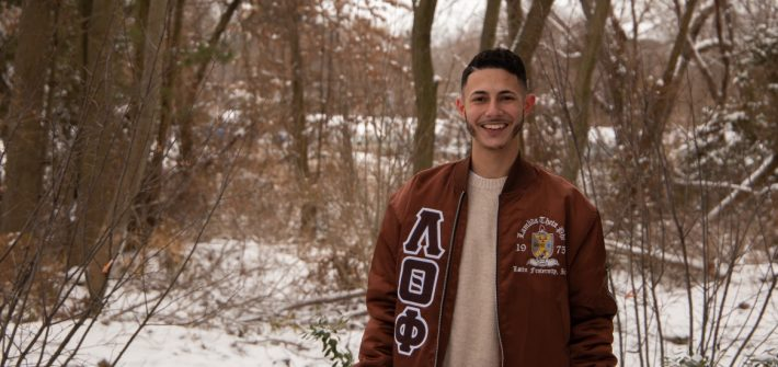 Chris Acevedo poses in a wooded, snowy area.