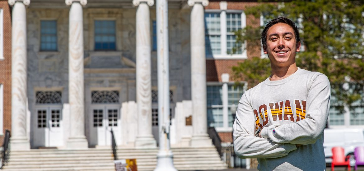 JT stands confidently in front of Bunce Hall.