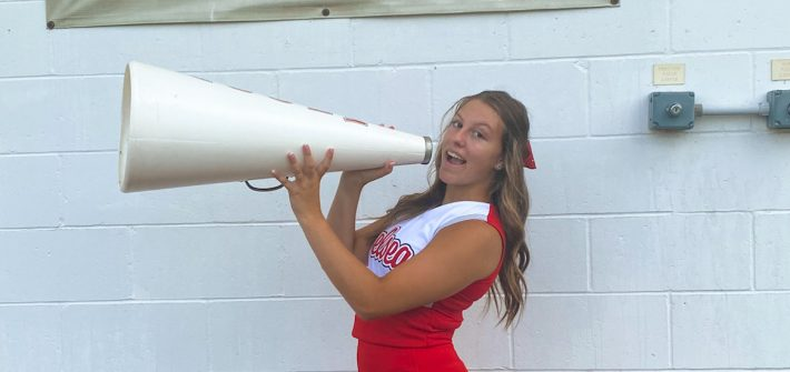 Madison wears a cheerleading uniform.