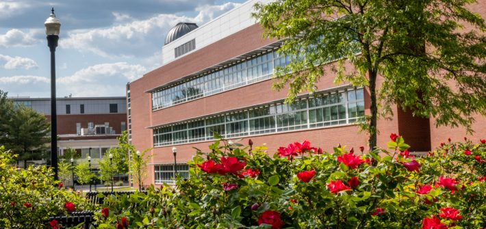 Photo of Science Hall and flowers in the foreground.
