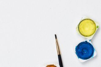 A stock photo of paintbrushes and paint