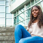 Keyanna sits on the steps by Engineering pond.
